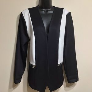 Project Runway jacket with front zipper pockets.